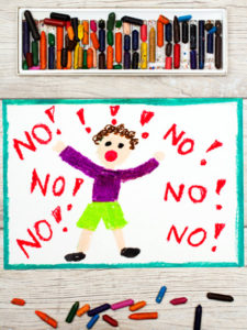 Photo of colorful drawing: Little boy screaming the word NO